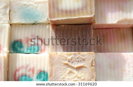stacks and rows of colorful handmade soaps - stock photo