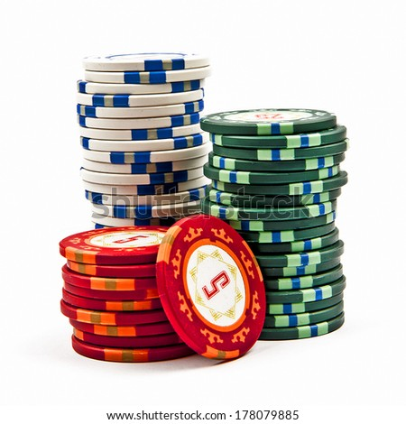 Stacks colored poker chips isolated over white background  - stock photo