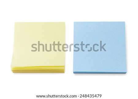 Stacks of blank yellow and blue sticky notes, isolated on white background. - stock photo