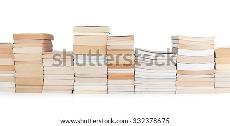 stacks of books in a row on white background - stock photo