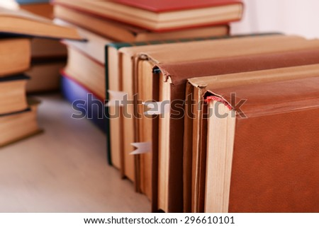 Stacks of books on table close up - stock photo