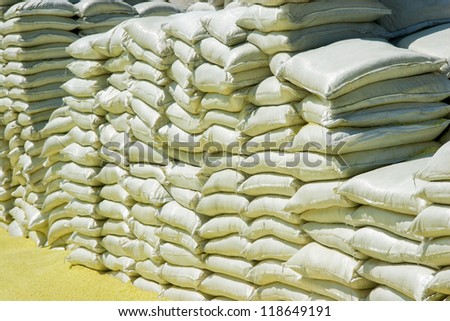 Stacks Of Chemical Sacks In Warehouse Outdoors - stock photo
