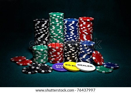 stacks of chips for poker with buttons of dealer, small blind and big blind - stock photo