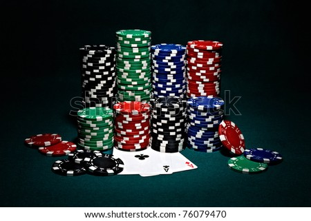 stacks of chips for poker with pair of aces - stock photo
