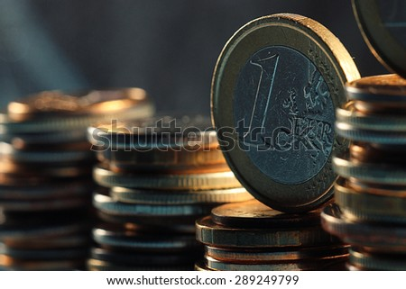 stacks of coins concept dollars euro dollar exchange rate economics - stock photo