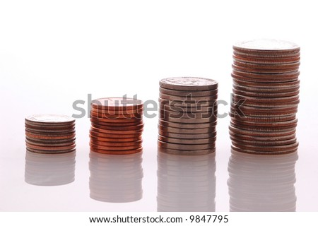 Stacks of Coins forming a Graph with reflections in tabletop - stock photo