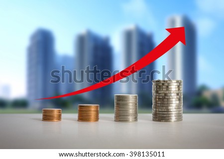 Stacks of coins in a growth real estate concepts. - stock photo