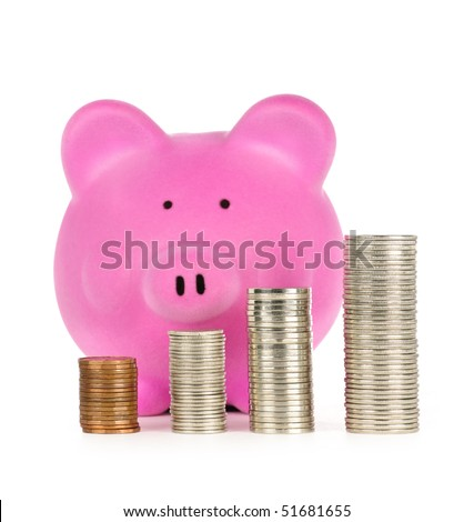 Stacks of coins in front of pink piggy bank showing growth - stock photo