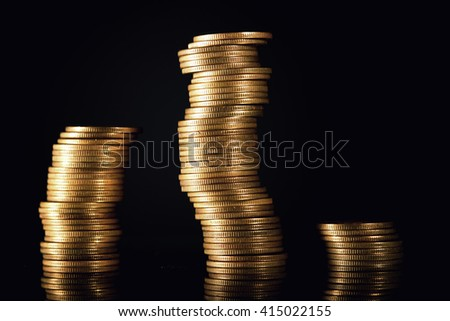 Stacks of coins isolated on black background, financial graph concept - stock photo