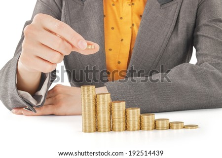 Stacks of coins like diagram with hand  - stock photo