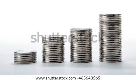 stacks of coins on a white background close up