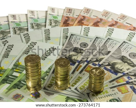 Stacks of coins 10 ruble banknote on the background of 1000, 5000 rubles, 100 euros and 100 dollars. Isolated image. - stock photo