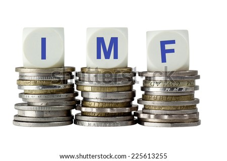 Stacks of coins with the letters IMF isolated on white background  - stock photo