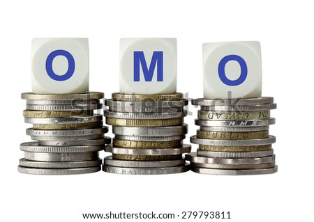 Stacks of coins with the letters OMO isolated on white background