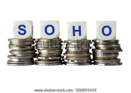 Stacks of coins with the letters SOHO isolated on white background  - stock photo
