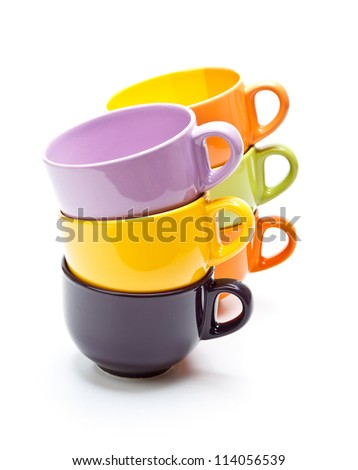 Stacks of colorful cups on white background