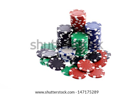 Stacks of colorful poker chips isolated over white background