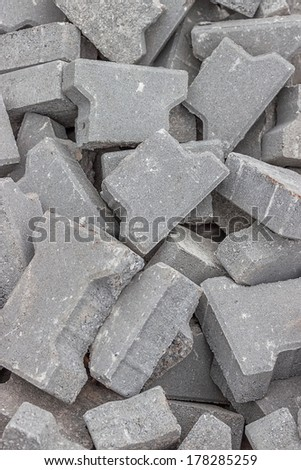 Stacks of cracked concrete pavers background at road construction site - stock photo