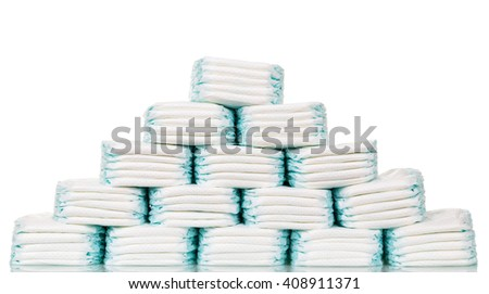 Stacks of diapers stacked in staggered rows isolated on a white background. - stock photo