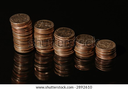 Stacks of dimes against a black background