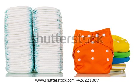 Stacks of disposable and cloth diapers modern isolated on white background.