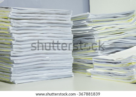 Stacks of documents on the table in the office