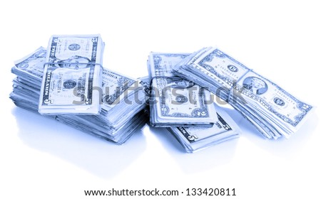 Stacks of dollars in blue light isolated on white