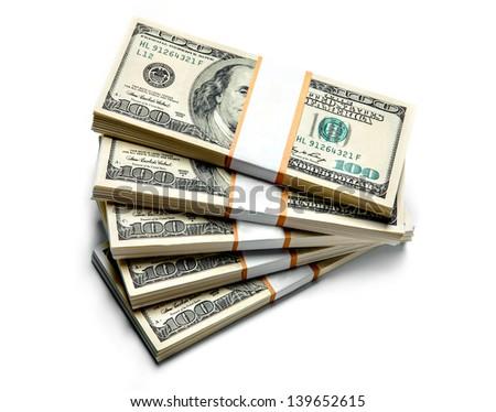 Stacks of dollars isolated on white background - stock photo