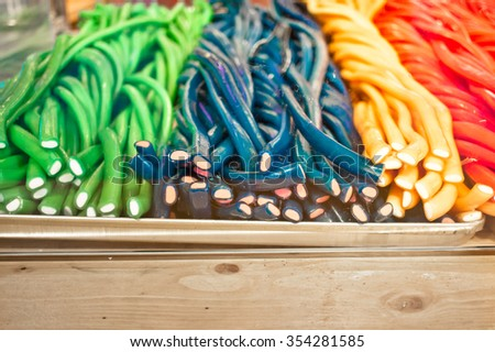 Stacks of festive candy at a market stall - stock photo