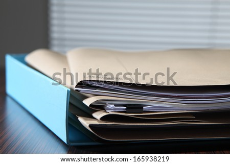 stacks of files waiting for solve