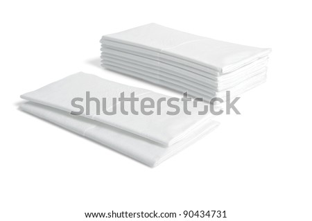 Stacks of folded disposable tissue papers on white background
