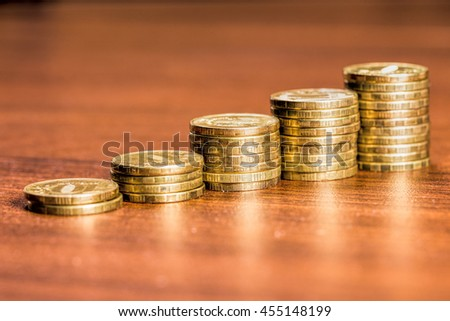 Stacks of gold coins of various heights