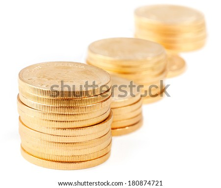 Stacks of gold coins - South African Krugerrands, isolated - stock photo
