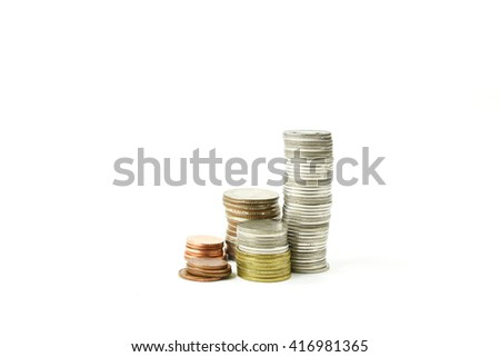 Stacks of gold,silver,copper coins. Income and profits. Isolated on white background. - stock photo