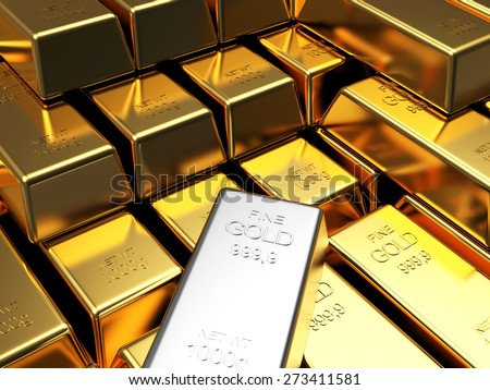 Stacks of golden bars with one of white gold. Business and financial background
