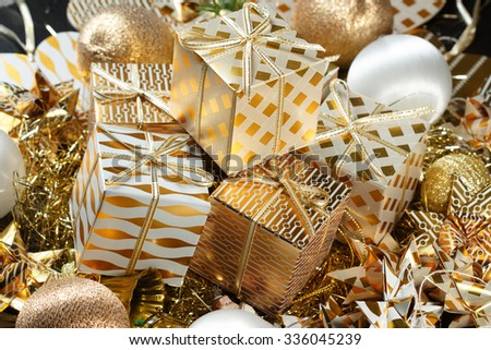 Stacks of golden Christmas presents - stock photo