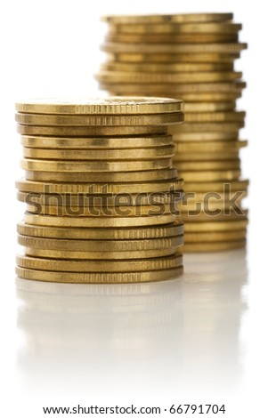 Stacks of golden coins. - stock photo
