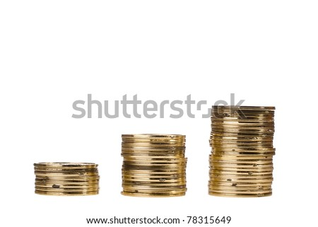 Stacks of golden coins isolated on a white background. - stock photo