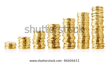 Stacks of golden coins isolated on white background. - stock photo