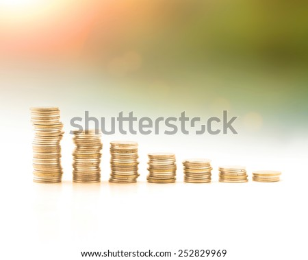 Stacks of golden coins over world map of clouds background. Money coin concept. Money coin concept. Debt, Money, Investment, Insurance Agent, Banking, Saving, Trust, LIT, Planing, Risk, Stock concept.