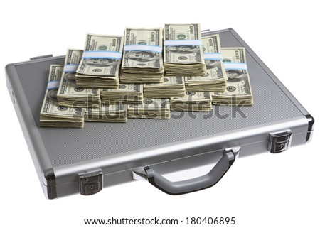 Stacks of hundred-dollar bills on a briefcase - stock photo