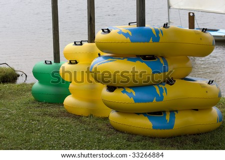 Stacks of inflatable rings for fun - stock photo