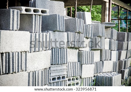 Stacks of interlocking stones for installing driveway landscaping - stock photo