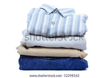 Stacks of manly colored clothes on white background - stock photo