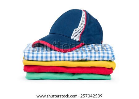Stacks of many colored clothes isolated on a white background - stock photo