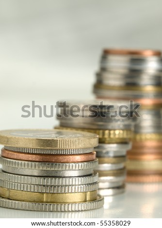 stacks of money coins of various currencies, closeup with shallow DOF , useful for various financial or economics themes - stock photo