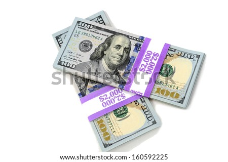 Stacks of new hundred dollar bills isolated on white background.  This newly redesigned US currency was released for circulation in October of 2013. - stock photo