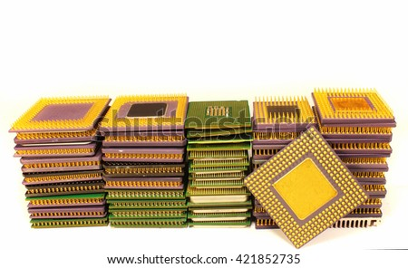 Stacks of old CPU chips and obsolete computer processors  - stock photo