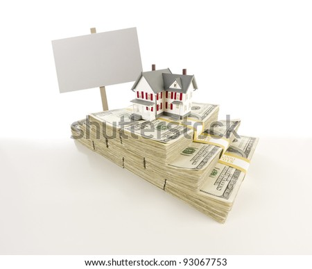 Stacks of One Hundred Dollar Bills with Small House and Blank Sign on Slight Gradation. - stock photo