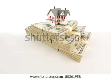 Stacks of One Hundred Dollar Bills with Small House on Slight Gradation. - stock photo